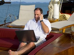 man-talking-on-phone-from-boat